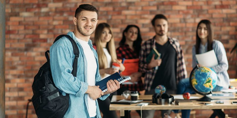 group-of-highschool-students-with-textbooks-team-KQ3C2YS